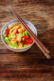 Blue ceramic cup noodles with vegetables, shrimps, green onions Royalty Free Stock Image