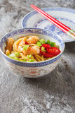 Blue ceramic cup noodles with vegetables, shrimps, green onions Stock Image