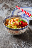 Blue ceramic cup noodles with vegetables, shrimps, green onions Stock Photos