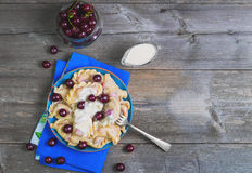 In blue ceramic dish, fruit and berry dumplings with cherries Stock Photo