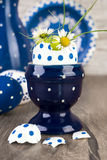 Blue ceramic Egg holder with flowers in egg shel, Happy Easter! Stock Photos