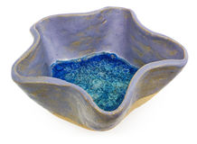 Blue, ceramic, handmade bowl in the shape of a star. At the bott Royalty Free Stock Images