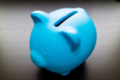 Blue ceramic piggy bank Stock Photography