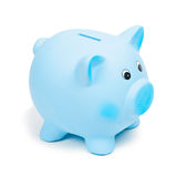 Blue ceramic piggy bank, isolated on white background. Bank savings, economy, financials investments, saving to buy a house, a car, for retirement concept Royalty Free Stock Images