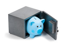 Blue ceramic piggy bank in a safe. Isolated on white background. Bank savings, economy, financials investments, saving to buy a house, a car, for retirement Stock Photo