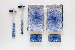 Blue ceramic sushi plates meal set up royalty free stock photos