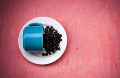 Blue Ceramic Tea Cup With Beans on Plate Stock Photo