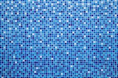 Blue ceramic tile mosaic. In swimming pool stock photography