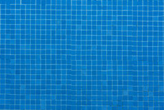 Blue ceramic tile mosaic in water swimming pool - seamless texture photo Royalty Free Stock Images