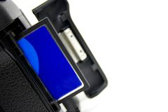 Blue CF. Blue Compact Flash card inserted halfway in digital SLR camera Stock Photos