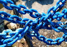 Blue chains. Old metallic chains in blue tone Stock Image