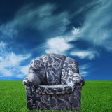 Blue chair. In green meadow stock photos