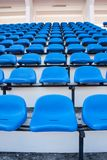 Blue chair. On the miraculous. To watch a sporting event Royalty Free Stock Photo