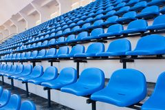 Blue chair. On the miraculous. To watch a sporting event Royalty Free Stock Photos