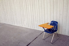 Blue chair with arm rest. Blue chair with armrest by the wall Stock Image