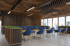 Blue chair cafe wooden interior side dark. Side view of a modern cafe or a coffee shop interior with dark wooden walls, panoramic windows and dark blue armchairs Stock Image