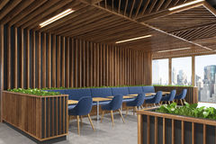 Blue chair cafe wooden interior side. Side view of a modern cafe or a coffee shop interior with wooden walls, panoramic windows and dark blue armchairs standing Royalty Free Stock Photo
