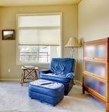 Blue chair in the corner with lamp interior. Royalty Free Stock Photos