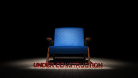 Blue chair in the dark with under construction sign 3D render. Ing Royalty Free Stock Photo