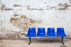 Blue chair on the floor with grunge background Stock Images