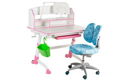 Blue chair, pink school desk, green basket and desk lamp Stock Images