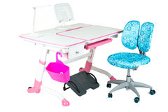 Blue chair, pink school desk, pink basket, desk lamp and black s Stock Photos