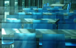 Blue chair and  plastic reflection. In moddern building Royalty Free Stock Images