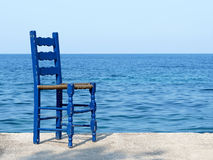 Blue chair at the sea in Greece Royalty Free Stock Image