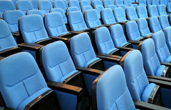 Blue chair seats in empty conference room. Wide-angle shot of blue chair seats in empty conference room Royalty Free Stock Image