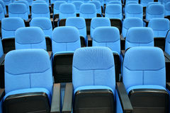 Blue chair seats in empty conference room. Close-up shot of blue chair seats in empty conference room Royalty Free Stock Image