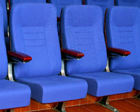 Blue chair seats in movie theater. Blue chair seats in an empty movie theater Royalty Free Stock Images