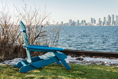 Blue chair on the waterfront with views of the city in the sprin Royalty Free Stock Photo