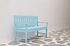 Blue chair in white room Stock Photography