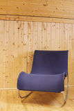 Blue chair in wooden interior Royalty Free Stock Images