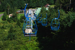 Blue chairlift. Chairlift in Pustevny, Czech republic Stock Photos