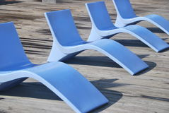 Blue chairs. A row of stylish deck chairs Royalty Free Stock Photography