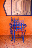 Blue chairs. Two blue chairs with a table Royalty Free Stock Photo