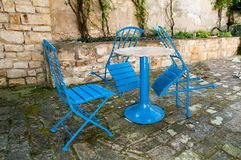 Blue chairs. Blue garden chairs around table Royalty Free Stock Image