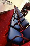 Blue chairs. Photo of blue chair in empty conferece room Stock Images