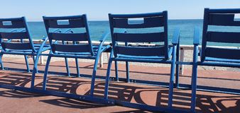 Blue Chairs Along The Promenade Des Anglais In Nice. Symbol Of Nice, Mediterranean Sea, French Riviera, France, Europe royalty free stock images