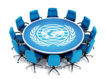 Blue chairs around round table with world and laurels symbol Royalty Free Stock Photography