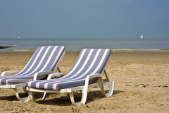 Blue chairs at beach Royalty Free Stock Photos