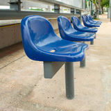 Blue chairs at bus stop Stock Images
