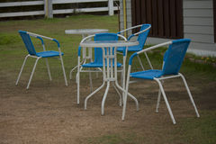 Blue Chairs With Glass topped Table Royalty Free Stock Images