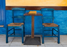 Blue chairs on a greek cafe Royalty Free Stock Photos