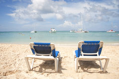 Blue Chairs Overlooking Tropical Ocean Royalty Free Stock Photo