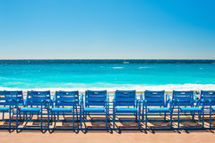 Blue chairs on the Promenade des Anglais in Nice, France Stock Image