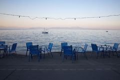 Blue chairs by the sea Stock Photography