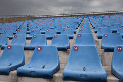 Blue chairs on a stadium Stock Image