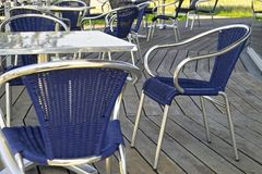 Blue chairs and table. In ht eopen caffee Royalty Free Stock Images
